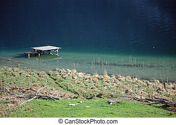 Aiguebelette lake and wooden pontoon, Savoy, France - View...