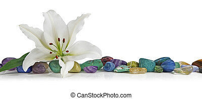 White Lily and Healing Crystals - A solitary lily place on...