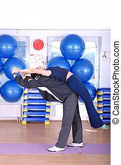 .happy couple recreating in fitness studio