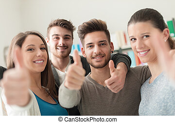 Cheerful friends with thumbs up - Cheerful group of friends...