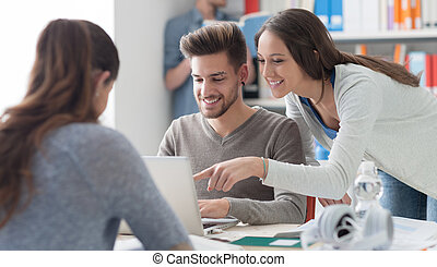 Students in the library - Group of college students studying...