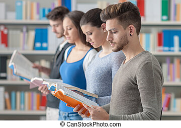 Group of students in the library - Group of college students...