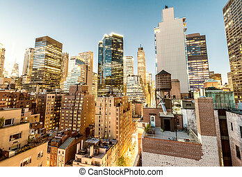 New York City. Midtown Manhattan buildings at sunset, aerial...