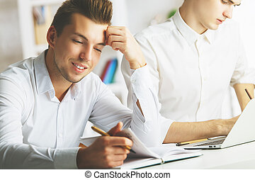 Men in office working on project