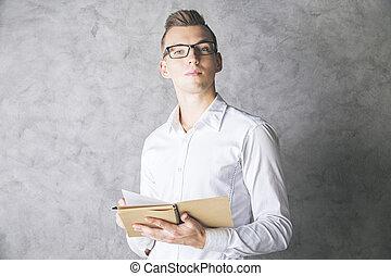Attractive gentleman with notepad