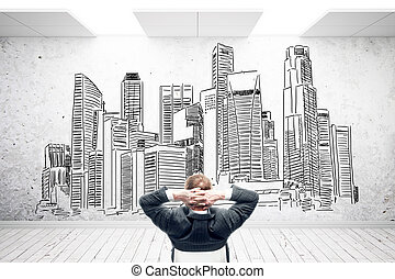 Man in room with city sketch - Relaxing businessman in room...