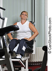 Mature woman work out in fitness - Mature healthy woman work...
