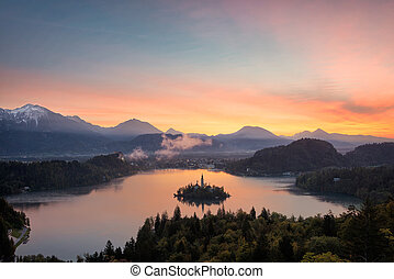 Bled lake sunrise view - View over Bled lake at sunrise with...