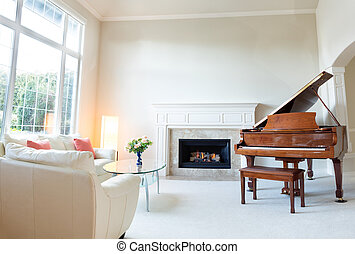 Living room decorated with leather sofa and piano with...