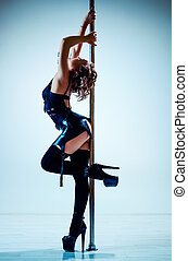 Pole dance woman - Young sexy pole dance woman in black...