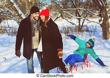 Happy family having fun snowy woodland outdoor
