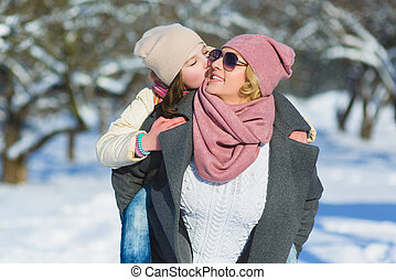 Happy family. Mother and daughter on a winter walk in nature