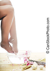 foot spa - woman spa pedicure foot treatment with water and...