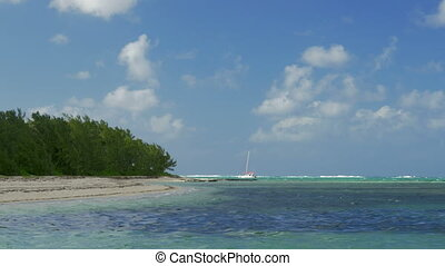 Picturesque view of strand and Indian Ocean and sailing...