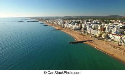 Aerial. Quarteira town in the Algarve, a video from the sky....