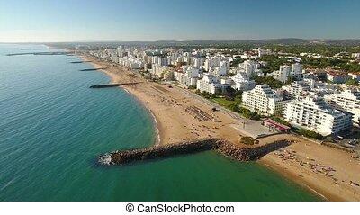 Aerial. Portuguese tourist town of Quarteira, filmed from...