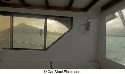 Fishing tackles on the back side of sailing yacht - Inside...