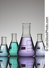 laboratory equipment - four conical glass flasks in a...