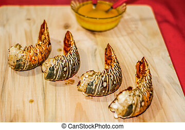 Lobster tails ready to eat - Photograph of four lobster...