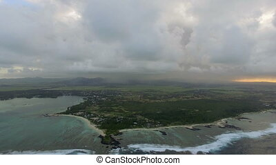 Flying over Mauritius with its blue lagoons - Aerial view of...
