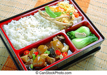 Bento food of plain rice and fried mushroom cabbage