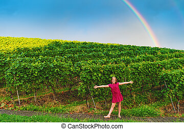 Little girl playing in vineyards, image taken in Lavaux,...