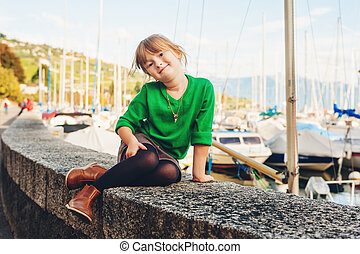 Fashion portrait of adorable 5 year old little girl resting...