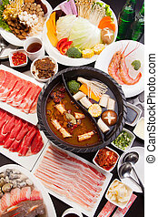 A special hot pot in Chinese style with beef, pork, seafood,...