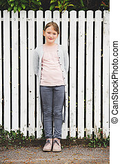 Fashion portrait of 7-8 year old little pretty girl wearing...