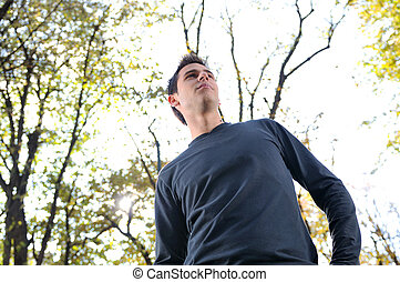 happy young casual man outdoor portrait posing