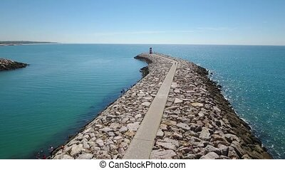 Aerial. Breakwater pier fishing port town Quarteira....