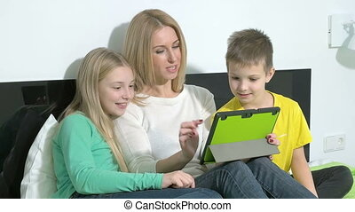 Attractive young family using a tablet to make future plans