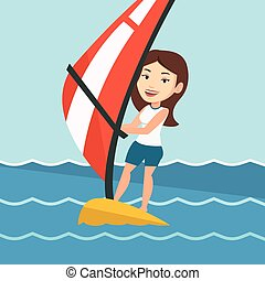 Young woman windsurfing in the sea. - Caucasian woman...