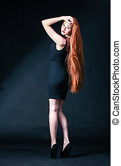 Beauty ginger Girl Portrait. Healthy Long Red Hair....