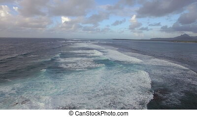 Foamy waves of Indian Ocean, aerial view - Flying over dark...