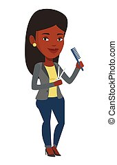 Hairstylist holding comb and scissors in hands. - Full...