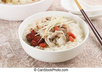 Golden fried mullet porridge for new year's dinner creations in asia