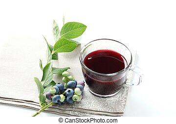 Blueberry juice with raw fruit and tea cup on white background