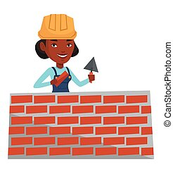 Bricklayer working with spatula and brick. -...
