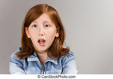 Shocked red head girl in jeans jacket - Portrait if young...