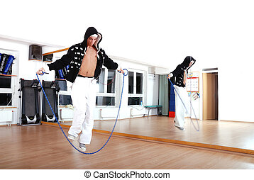 .young man using a jump rope - Break Dance Indoor B Boys