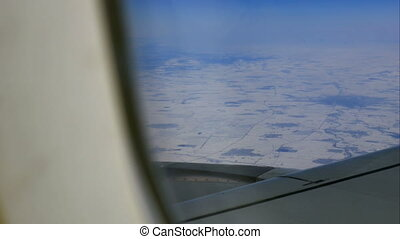Aircraft wing and picturesque mountain landscape from high...