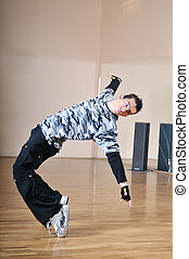 break dance - young man performing break dance in dance...