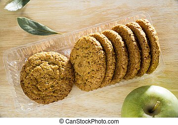 Oatmeal cookies with apple and bay leaf top view