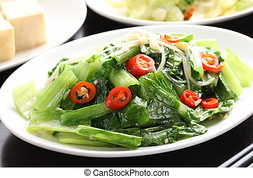 Seasonal vegetables with cabbage and chili on white plate