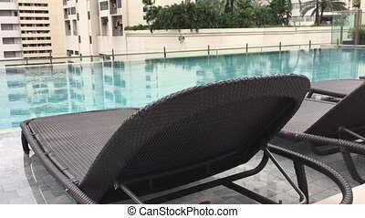 Rooftop luxury swimming pool - Slow motion pan of luxurius...