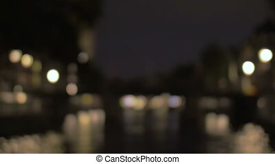 View to night Amsterdam with canal and bridge - Defocused...
