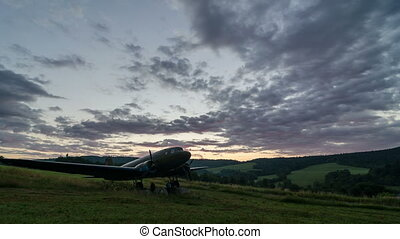 Sunrise over vintage military aircraft time lapse. Beautiful morning color on trek