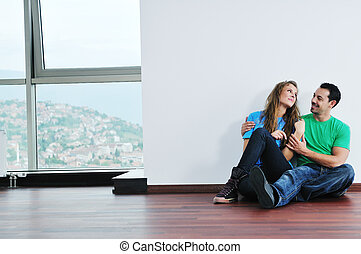 happy couple in empty apartment - happy young cuple have fun...