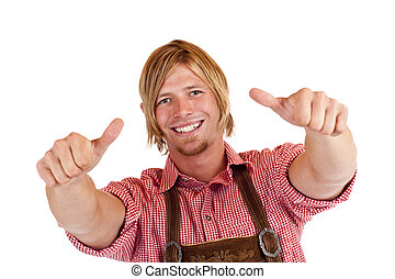 Bavarian man with oktoberfest leather trousers (Lederhose) shows both thumbs up